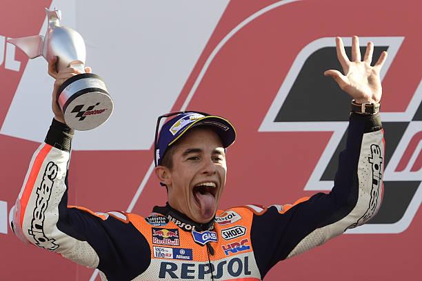 7342dbd7eca6 World Champion Repsol Honda Team s Spanish rider Marc Marquez celebrates on  the podium after the MotoGP