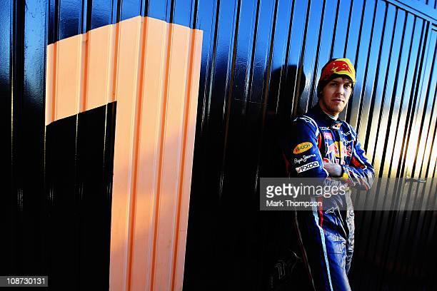 World Champion Sebastian Vettel of Germany and Red Bull Racing poses for a photograph behind his team garage during day two of winter testing at the...
