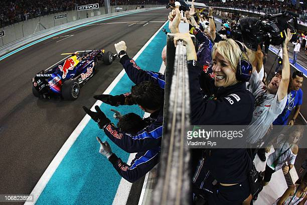 World Champion Sebastian Vettel of Germany and Red Bull Racing crosses the finishing line in front of team mates to win the Abu Dhabi Formula One...