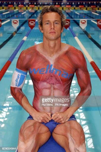 World Champion swimmer Mark Foster has his body painted head to toe to reveal his muscle definition at Ponds Forge International Sports Centre...