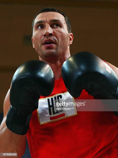 World Champion Wladimir Klitschko of Ukraine exercises during the official training session ahead of his IBF WBA WBO and IBO World Championship fight...