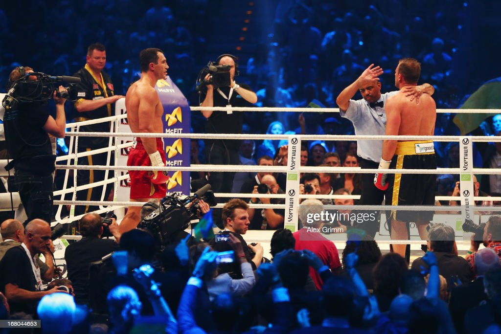 World Champion Wladimir Klitschko of Ukraine waits in the corner as referee Ernest Sharif stands in front of challenger Francesco Pianeta and stops their IBF IBO WBA WBO World Championship fight at SAP Arena on May 4, 2013 in Mannheim, Germany.