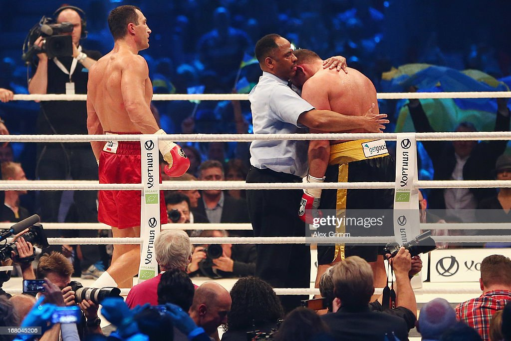 World Champion Wladimir Klitschko of Ukraine waits in the corner as referee Ernest Sharif holds challenger Francesco Pianeta after stopping their IBF IBO WBA WBO World Championship fight at SAP Arena on May 4, 2013 in Mannheim, Germany.