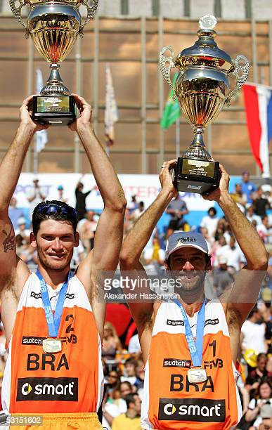 World champions Fabio Luiz de Jesus Magalhaes and Marcio Henrique Barroso Araujo of Brazil pose with the World Champion trophy and their Gold Medals...