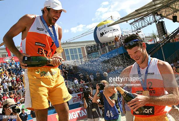 World champions Fabio Luiz de Jesus Magalhaes and Marcio Henrique Barroso Araujo of Brazil celebrate with champagne after winning the final match...