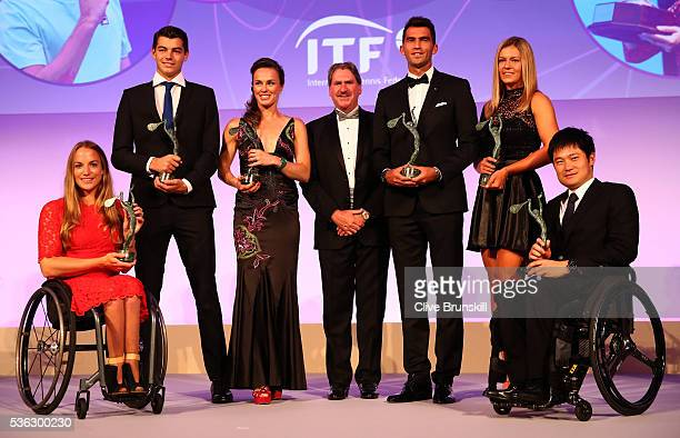 World Champions Jiske Griffioen of Netherlands Taylor Fritz of the United States Martina Hingis of Switzerland ITF President David Haggerty Horia...