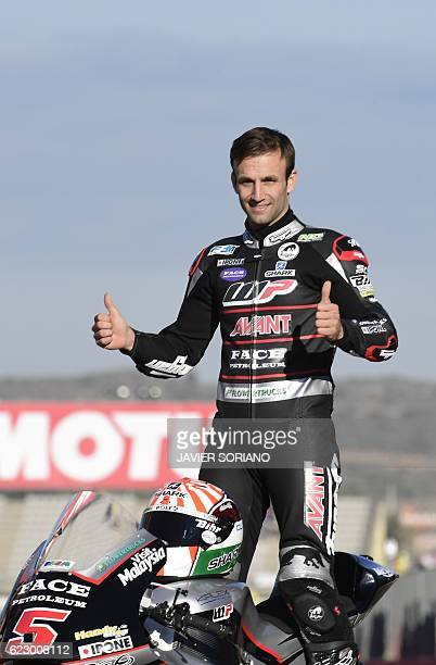 World Champions Moto2 Ajo Motorsport's French rider Johann Zarco poses after the MotoGP race of the Motul Comunidad Valenciana Grand Prix at the...