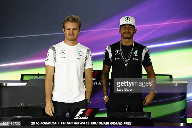 World Championship contenders Lewis Hamilton of Great Britain and Mercedes GP and Nico Rosberg of Germany and Mercedes GP pose for a photo before...