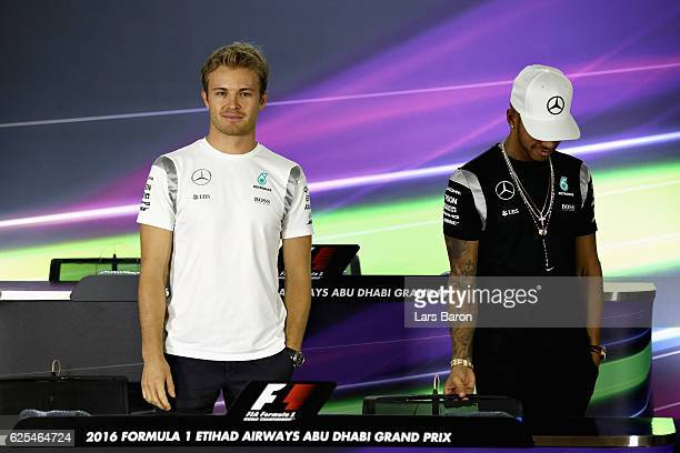 World Championship contenders Lewis Hamilton of Great Britain and Mercedes GP and Nico Rosberg of Germany and Mercedes GP before conducting a press...
