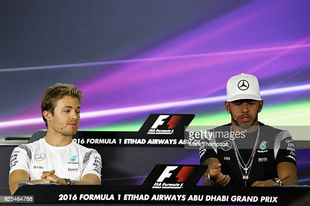 World Championship contenders Lewis Hamilton of Great Britain and Mercedes GP and Nico Rosberg of Germany and Mercedes GP conduct a press conference...