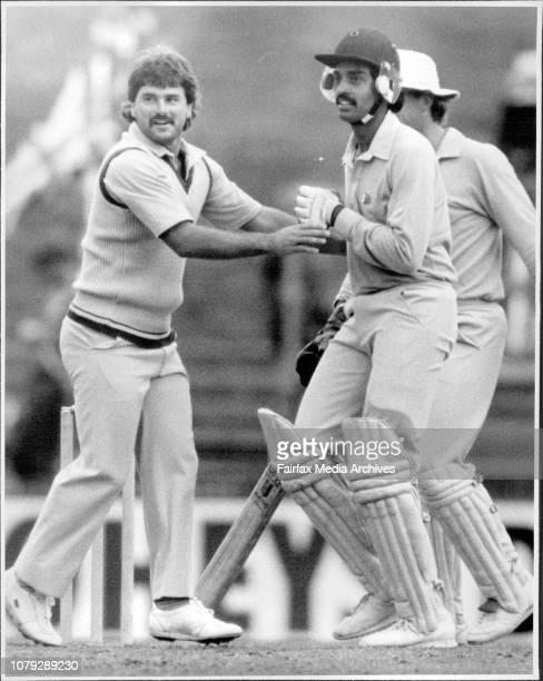 World Championship Of Cricket: England V India.Allan Lamb grabs hold off Dilip Venosarkar in an attempt to stop him getting runs. February 26, 1985. .