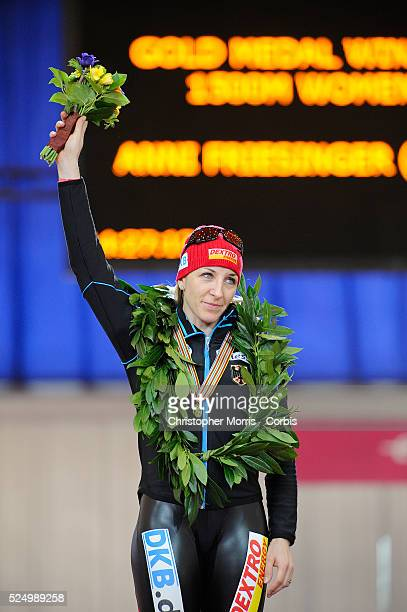Ani Friesinger of Germany celebrates on the podium after winning a gold medal in the Women's 1500 meter at the Richmond Olympic Oval site of the...
