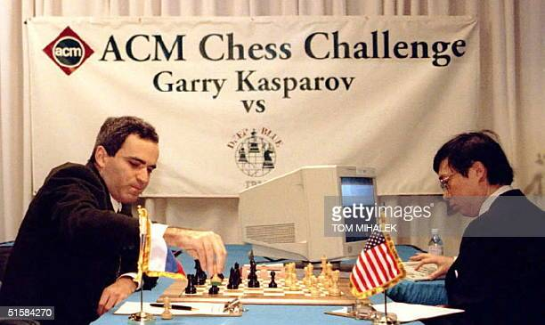 World chess champion Garry Kasparov L takes a pawn in the opening minutes of a sixgame sixday chess match against IBM's Deep Blue computer in...