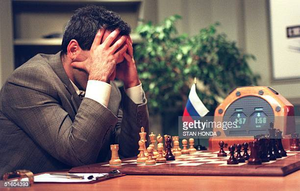 World Chess Champion Garry Kasparov looks at the chessboard before his next move in the early part of the fifth game against the IBM Deep Blue...