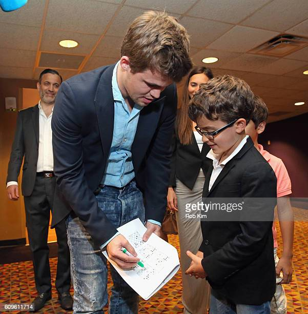 World Chess Champion Magnus Carlsen greets a fan after partipating in a QUEEN OF KATWE Q&A with real life film subjects Robert Katende and Phiona...