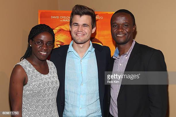 World Chess Champion Magnus Carlsen poses with real life film subjects Phiona Mutesi and Robert Katende before participating in a QUEEN OF KATWE Q&A...