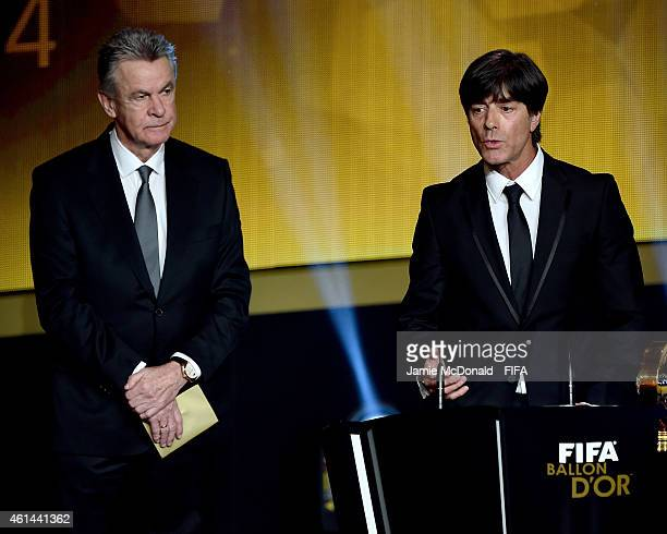 World Coach of the Year for Men's Football winner Joachim Loew of Germany receives his award from Ottmar Hitzfeld during the FIFA Ballon d'Or Gala...