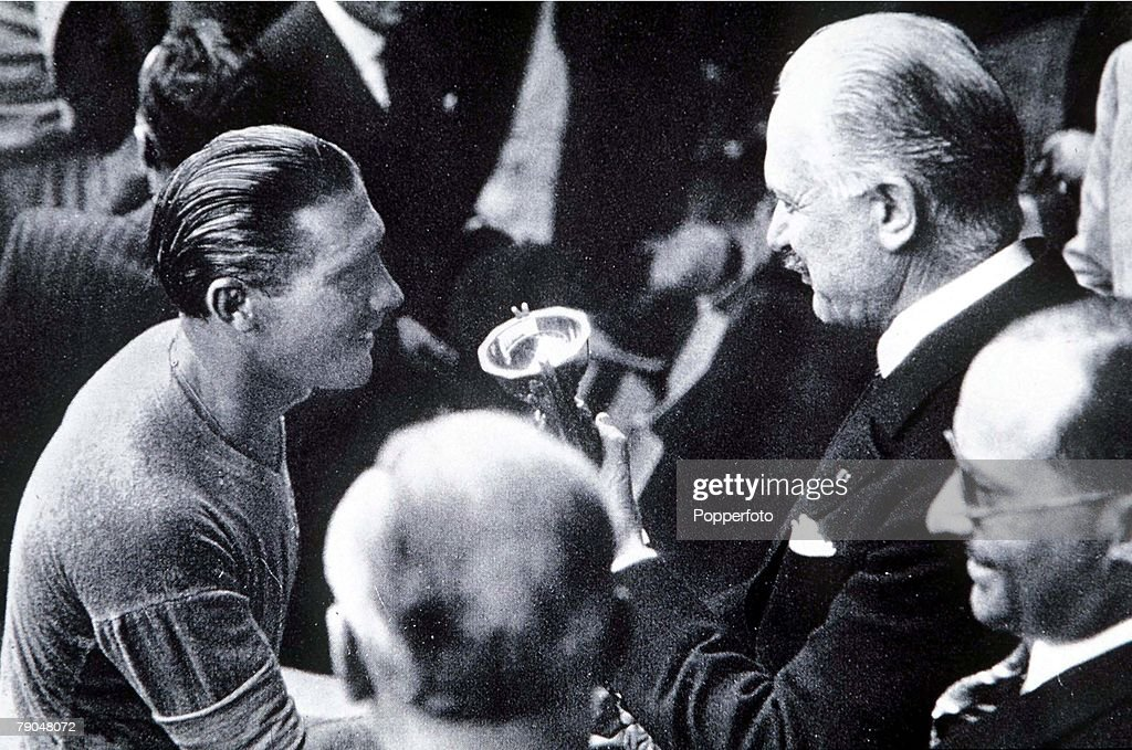 World Cup 1938. Final. Paris, France. 19th June, 1938. Italy 4 v Hungary 2. Italian captain Giuseppe Meazza (left) receives the Jules Rimet World Cup trophy from French Preisdent M. Lebrun after defeating Hungary in the Final. : News Photo