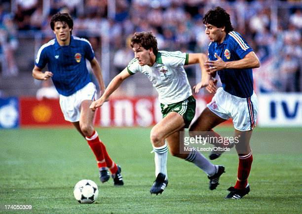 World Cup 1982 Spain Northern Ireland v Yugoslavia Norman Whiteside slips through the Yugoslav midfield Norman was 17 years and 42 days old when he...