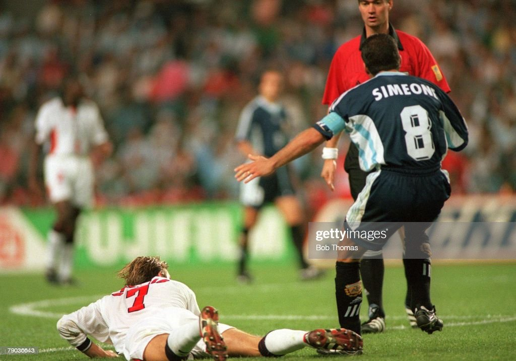 World Cup 1998 Finals, St. Etienne, France. 30th June, 1998. England 2 v Argentina 2 (Argentina win 4-3 on penalties). The incident in which England's David Beckham kicks out at Diego Simeone in front of the referee, resulting in his red card. : News Photo