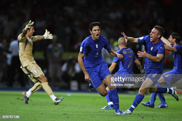 World Cup 2006 Final : Daniele De Rossi of Italy goes to congratulate Fabio Grosso after scoring the winning penalty kick in the shoot out