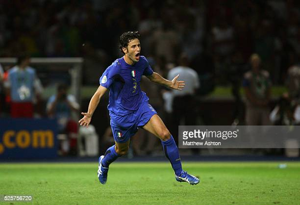Fabio Grosso of Italy celebrates after scoring the winning penalty kick during the shoot out