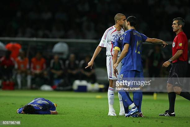 Marco Materazzi of Italy lies on the floor after being headbutted by Zinedine Zidane of France