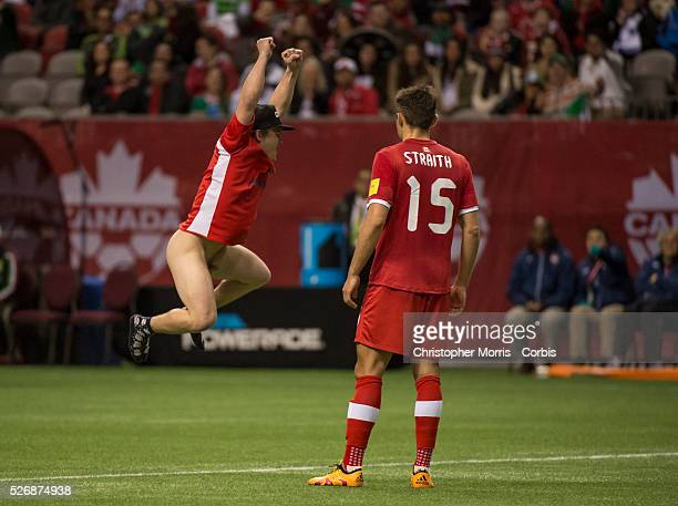World Cup 2018 Adam Straith of team Canada looks on as a streaker runs on the field at BC Place Stadium in Vancouver during FIFA World Cup 2018...