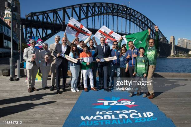 World Cup 2020 Local Organising Committee CEO Nick Hockley and New South Wales Minister for Sport John Sidoti MP pose with cricket supporters after...