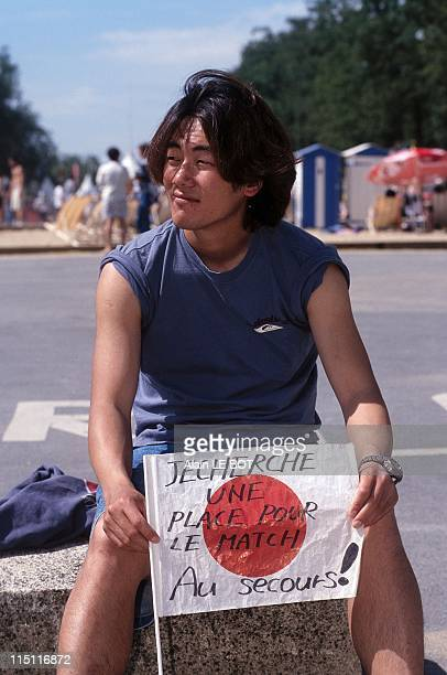 World cup 98 young japanese looking for tickets in Nantes France on June 18 1998