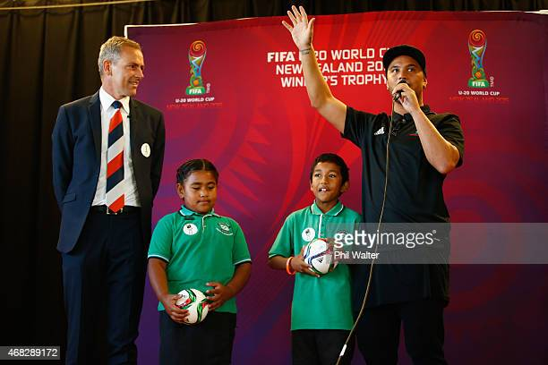 World Cup CEO Dave Beeche and New Zealand musician and NZ Idol Judge Stan Walker stand with school children Kazitoa Farani and Matilda Lako after...