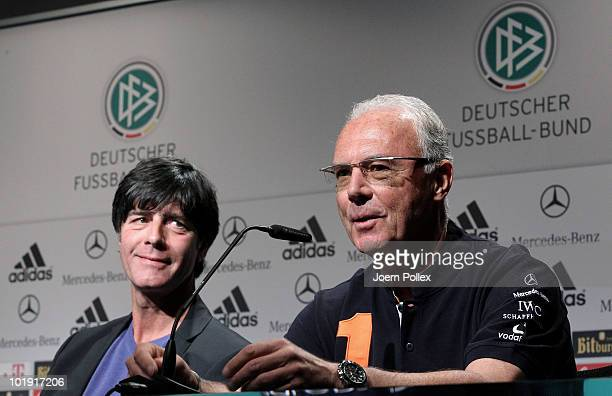 World Cup champion and football legend Franz Beckenbauer of Germany and head coach Joachim Loew of Germany attend a press conference in the media...