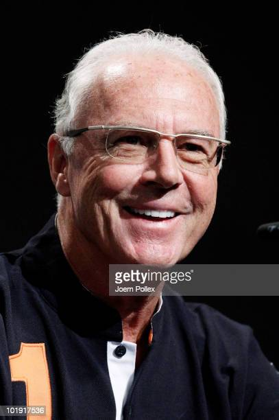 World Cup champion and football legend Franz Beckenbauer of Germany smiles during a press conference in the media center at Velmore Grande Hotel on...