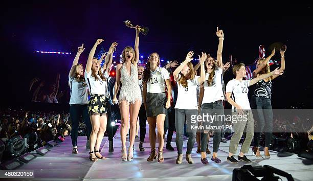 World Cup Champions US Women's Soccer National Team Heidi Klum and Taylor Swift onstage during The 1989 World Tour Live at MetLife Stadium on July 10...
