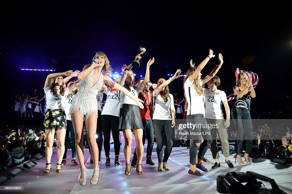 World Cup Champions U.S. Women's Soccer National Team, Heidi Klum and Taylor Swift onstage during The 1989 World Tour Live at MetLife Stadium on July 10, 2015 in East Rutherford, New Jersey.