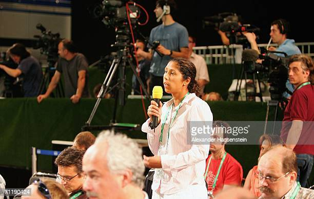 World Cup commentator and German women's national foolball team player Steffi Jones asks questions at a press conference on June 13 2006 in Berlin...