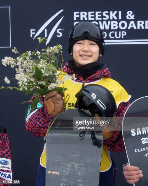 World Cup debutant Yuto Totsuka of Japan celebrates after winning a men's snowboard halfpipe event in Cardrona New Zealand on Sept 8 2017 ==Kyodo