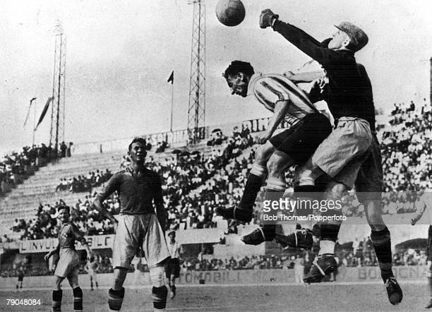 World Cup EighthFinal Bologna Italy 27th May Sweden 3 v Argentina 2 Swedish goalkeeper Rydberg punches clear under pressure from Argentina's captain...
