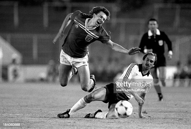 World Cup - England v West Germany, Bryan Robson flies through the air after being tackled by Ulrich Stielike.
