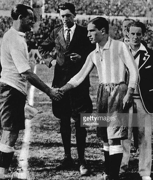 World Cup Final 1930 Montevideo Uruguay Uruguay 4 v Argentina 2 Belgian referee John Langenus looks on as Uruguay's captain Jose Nasazzi shakes hands...