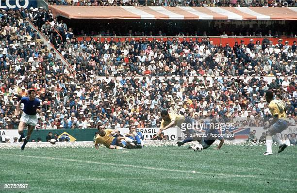 World Cup Final 1970 Mexico City Mexico 21st June Brazil 4 v Italy 1 Brazil's Jairzinho is tackled by an Italian defender as teamates Pele and Tostao...