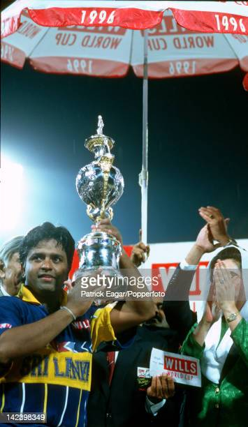 """World Cup Final 1996 Sri Lanka v Australia at Lahore Arjuna Ranatunga, the Sri Lankan captain, with the World Cup which he had just received from..."