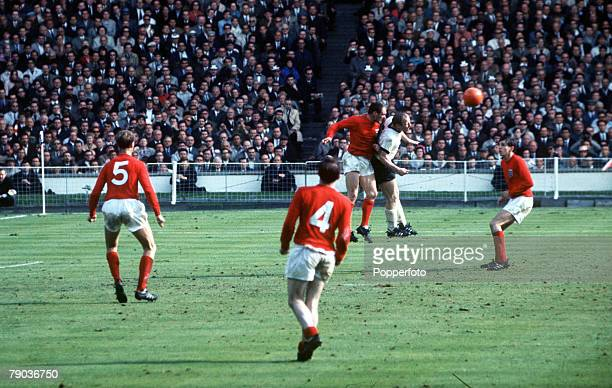 World Cup Final 30th July Wembley Stadium England England 4 v West Germany 2 England defender Ray Wilson jumps up to head the ball clear from West...