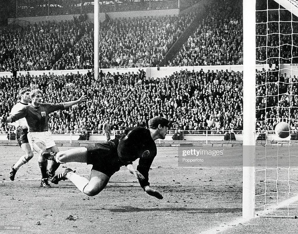 World Cup Final, 1966. 30th July, 1966. Wembley Stadium, England. England 4 v West Germany 2. England's controversial third goal scored by Geoff Hurst in the first half of extra time. German goalkeeper Hans Tilkowski dives for the ball after it had hit th : News Photo