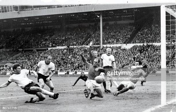 World Cup Final 30th July Wembley Stadium, England, England 4 v West Germany 2, England's captain Bobby Moore appeals for offside as Ray Wilson and...