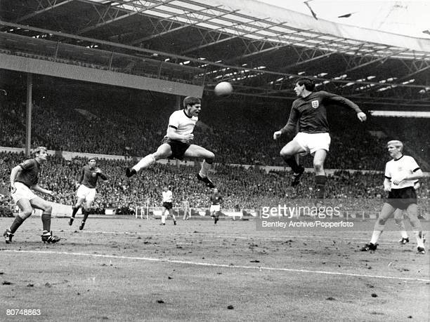 World Cup Final 30th July Wembley Stadium England England 4 v West Germany 2 West Germany's Wolfgang Weber and England's Martin Peters both jump for...
