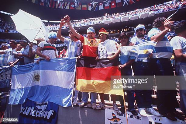 World Cup Final Azteca Stadium Mexico 29th June Argentina 3 v West Germany 2 Friendly fans of both teams cheer their teams on waving flags and banners