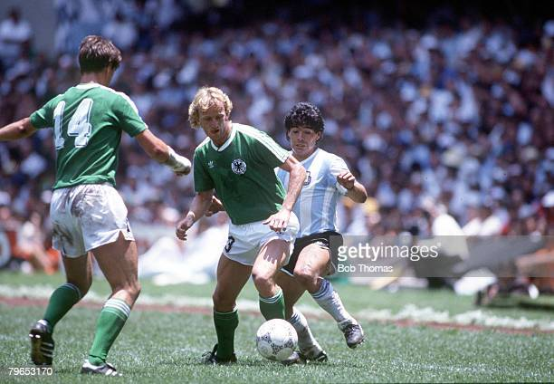 World Cup Final Azteca Stadium Mexico 29th June Argentina 3 v West Germany 2 West Germany's Thomas Berthold and Andreas Brehme are challenged by...