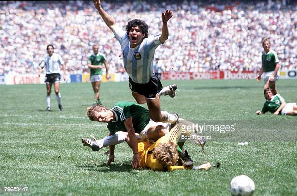 World Cup Final Azteca Stadium Mexico 29th June Argentina 3 v West Germany 2 Argentina's Diego Maradona goes flying over the challenges of West...