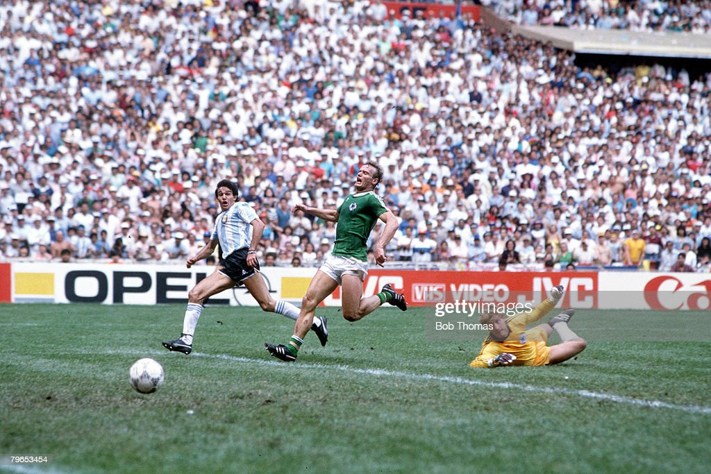 1986 World Cup Final, Azteca Stadium, Mexico, 29th June, 1986, Argentina 3 v West Germany 2, Argentina's Jorge Burrachaga scores the winning goal past West German goalkeeper Harald Schumacher and defender Hans Peter Briegel : News Photo